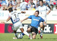 24 October 2004: Ian Russell of Earthquakes tries to block Diego Gutierrez of Wizards during the first half of the game at Spartan Stadium in San Jose, California.   Earthquakes defeated Wizards, 2-0.  Credit: Michael Pimentel / ISI