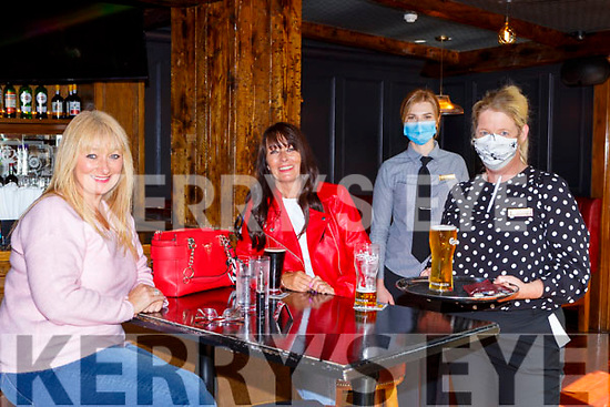 Caroline Stack and Patricia O'Sullivan Tralee is served by Ruth Goggin and Lina Simaityte in Scott's Hotel Snug bar on Monday