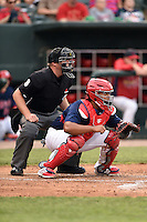 Home plate umpire Spencer Flynn and Memphis Redbirds catcher Audry Perez (40) wait for the pitch during a game against the Oklahoma City RedHawks on May 23, 2014 at AutoZone Park in Memphis, Tennessee.  Oklahoma City defeated Memphis 12-10.  (Mike Janes/Four Seam Images)