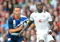 July 26, 2012..Britain's Ryan Giggs (11) and Senegal's Zargo Toure (6). Great Britain vs Senegal Football match during 2012 Olympic Games at Old Trafford in Manchester, England. Senegal held Great Britain to a 1-1 draw...(Credit Image: © Mo Khursheed/TFV Media)