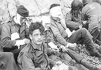 American assault troops of the 16th Infantry Regiment, injured while storming Omaha Beach, wait for the Chalk Cliffs for evacuation to a field hospital for further medical treatment.  Collville-sur-Mer, Normandy, France.  June 6, 1944.  Taylor.  (Army)<br /> NARA FILE #:  111-SC-189910<br /> WAR & CONFLICT BOOK #:  1043
