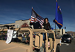 """Gov. Brian Sandoval and his wife Kathleen wave to the crowd at the 74th annual Nevada Day parade in Carson City, Nev. on Saturday, Oct. 27, 2012. This years theme was """"Honoring Our Military & Families - Past, Present, Future."""".Photo by Cathleen Allison"""
