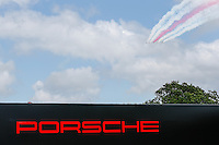 The Red Arrows fly above the Porsche stand at Goodwood Festival of Speed 2016 at Goodwood, Chichester, England on 24 June 2016. Photo by David Horn / PRiME Media Images