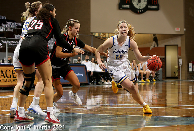 SIOUX FALLS, SD - MARCH 6: Tori Nelson #20 of the South Dakota State Jackrabbits drives to the basket past Sophie Johnston #42 of the Omaha Mavericks during the Summit League Basketball Tournament at the Sanford Pentagon in Sioux Falls, SD. (Photo by Dave Eggen/Inertia)