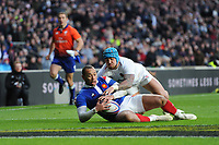 Gaël Fickou of France touches down just ahead of Jack Nowell of England during the Guinness Six Nations match between England and France at Twickenham Stadium on Sunday 10th February 2019 (Photo by Rob Munro/Stewart Communications)