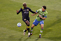 COLUMBUS, OH - DECEMBER 12: Gyasi Zardes #11 of Columbus Crew battles for the ball against Shane O'Neill #27 of Seattle Sounders FC during a game between Seattle Sounders FC and Columbus Crew at MAPFRE Stadium on December 12, 2020 in Columbus, Ohio.