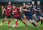 Ross County v St Johnstone....07.04.15   SPFL<br /> Chris Millar battles with Craig Curran<br /> Picture by Graeme Hart.<br /> Copyright Perthshire Picture Agency<br /> Tel: 01738 623350  Mobile: 07990 594431