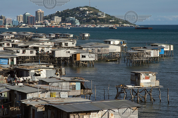 Stilt houses in Hanuabada, a traditional Motuan village, with the CBD of Port Moresby in the distance.