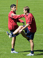 Claudio Reyna and Eddie Lewis, right, warm up before training in Hamburg, Germany, for the 2006 World Cup, June, 6, 2006.
