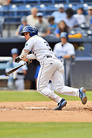 Asheville Tourists Kyle Datres (3) lays down a bunt during a game against the Lakewood BlueClaws at McCormick Field on August 4, 2019 in Asheville, North Carolina. The Tourists defeated the BlueClaws 13-6. (Tony Farlow/Four Seam Images)
