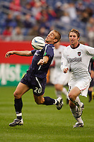 The MetroStars' Jeff Parke attempts to catch up with the New England Revolution's Taylor Twellman as he breaks to the goal. The New England Revolution tied the NY/NJ MetroStars one all at Gillette Stadium, Foxborough, MA, on May 22, 2004.