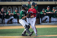 Justin Lavey (16) of the Louisville Cardinals is tagged out by Wake Forest Demon Deacons catcher Logan Harvey (15) in the top of the fifth inning at David F. Couch Ballpark on March 17, 2018 in  Winston-Salem, North Carolina.  The Cardinals defeated the Demon Deacons 11-6.  (Brian Westerholt/Four Seam Images)