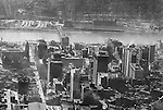 Pittsburgh PA:  Aerial view of City of Pittsburgh skyline looking southwest over the Pennsylvania Railroad Station toward the Monongahela River, Smithfield Street Bridge, the South Side, and the P&LE Railroad building and rail yards across the river.