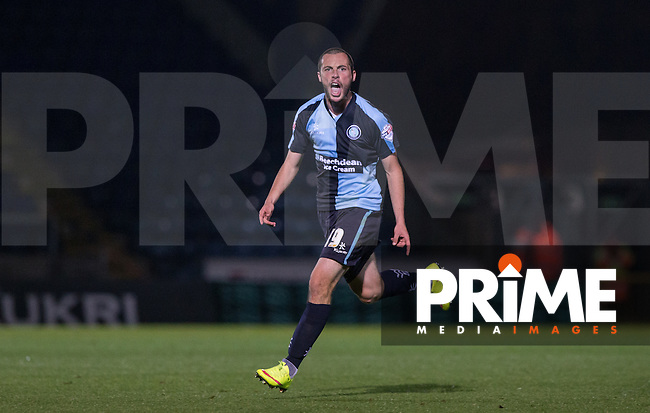 Michael Harriman of Wycombe Wanderers celebrates scoring the winning goal as his team go top of league 2 with a 1-0 victory during the Sky Bet League 2 match between Wycombe Wanderers and Cambridge United at Adams Park, High Wycombe, England on 29 September 2015. Photo by Andy Rowland.