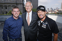 August  2012 File Photo - Montreal (Quebec) CANADA -  Nascar driver  Justin Allgaier (L) and Alexandre Tagliani (R) pose with Mayor Gerald Tremblay (M) at Montreal City Hall on August 16 2012.<br /> <br /> Les coureurs automobile de NASCAR  Justin Allgaier (G), Alexandre Tagliani (D) pose avec le Maire Gerald tremblay (M) a l'Hotel de Villle de Montreal, le 16 aout 2012.
