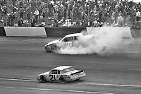 HAMPTON, GA - NOV 3:  Dave Marcis, #71 Chevrolet, crashes as Rick Wilson, #21 Chevrolet, races past during the Atlanta Journal 500 NASCAR Winston Cup race at Atlanta Motor Speedway, November 3, 1985. (Photo by Brian Cleary/www.bcpix.com)