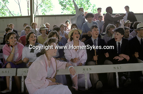 Eton harrow cricket match at Lords London. Students schoolboys and sisters cheer on their school team. The English Season published by Pavilon Books 1987