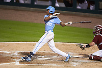 Justice Thompson (20) of the North Carolina Tar Heels follows through on his swing against the South Carolina Gamecocks at Truist Field on April 6, 2021 in Charlotte, North Carolina. (Brian Westerholt/Four Seam Images)