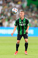 AUSTIN, TX - JUNE 19: Alex Ring #8 of Austin FC looks to gain control of a loose ball during a game between San Jose Earthquakes and Austin FC at Q2 Stadium on June 19, 2021 in Austin, Texas.