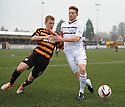 Raith Rovers' Jason Thomson holds off Alloa's Liam Caddis.
