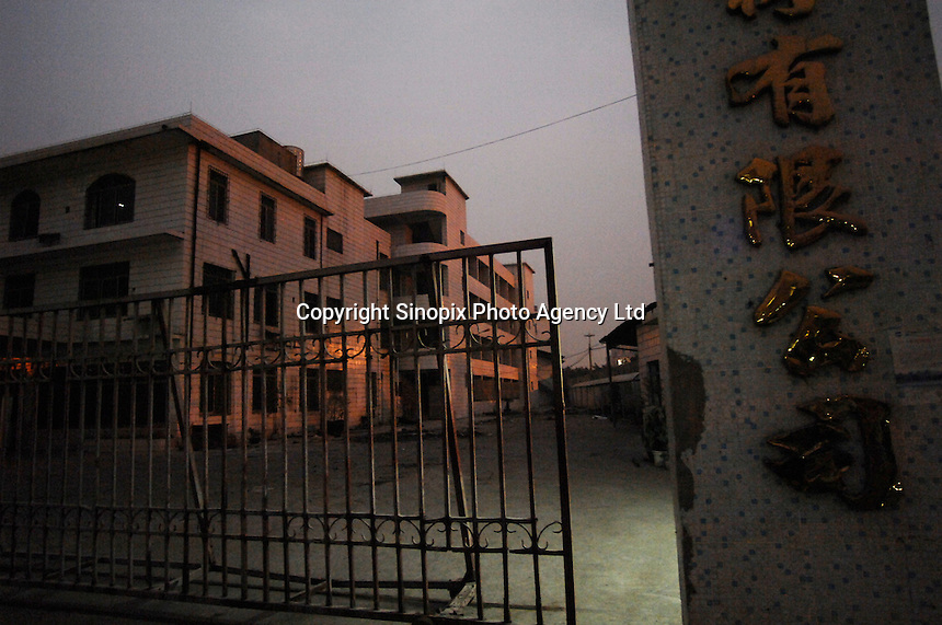 A deserted factory in Houjie Town, Dongguan, China.  Many of the factories closed leaving workers unpaid. The workers dstroyed some factories. As the economy changes and Chinese labour gets more expensive, factories are closing leaving ghost towns behind them..20 Dec 2007