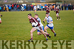 Piarsaigh na Dromoda's Shane O'Connor breaks free of the challenges of St Marys Adam Quirke and Darren Casey.