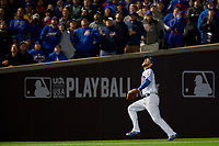 Chicago Cubs left fielder Ben Zobrist (18) settles under a fly ball in the eighth inning during Game 5 of the Major League Baseball World Series against the Cleveland Indians on October 30, 2016 at Wrigley Field in Chicago, Illinois.  (Mike Janes/Four Seam Images)
