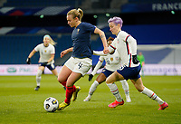 LE HAVRE, FRANCE - APRIL 13: Marion Torrent #4 of France attempts to move around Megan Rapinoe #15 the United States during a game between France and USWNT at Stade Oceane on April 13, 2021 in Le Havre, France.