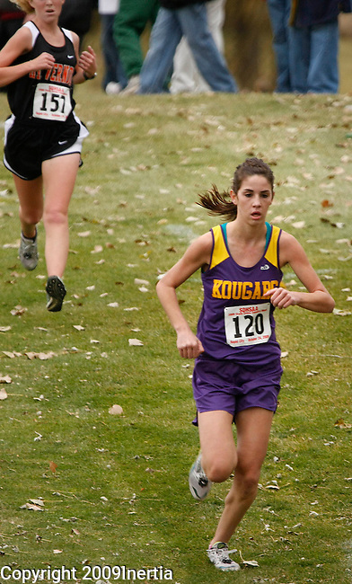 RAPID CITY, SD -- OCTOBER 24, 2009 -- Tia Carlson of Kadoka Area runs to the finish in the girls class B event at the 2009 South Dakota State High School Cross Country Meet Saturday in Rapid City. (Photo by Dick Carlson/Inertia)