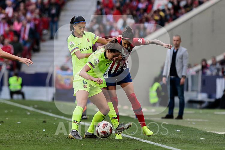 Atletico de Madrid's Jennifer Hermoso and FC Barcelona's Marta Torrejon (L) and Andressa Alver (R) during Liga Iberdrola match between Atletico de Madrid and FC Barcelona at Wanda Metropolitano Stadium in Madrid, Spain. March 17, 2019. (ALTERPHOTOS/A. Perez Meca)