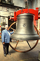 BNPS.co.uk (01202 558833)<br /> Pic:  BNPS<br /> <br /> Laith Reynolds with the tenner bell.<br /> <br /> The first English 'ring of bells' in Asia has been hung and rung as the unique art<br /> form continues to spread around the globe.<br /> There are now hangs in St Andrew's Anglican Cathedral in Singapore a 'ring of 12'<br /> that is tuned and hung to be used in the full-circle change-ringing style.<br /> Experienced campanologists are training locals in the art, known as The Exercise,<br /> so this English sound can be heard regularly in the city-state.