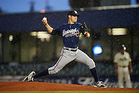 Mississippi Braves pitcher Jake Brigham (49) delivers a pitch in the rain during a game against the Mobile BayBears on April 28, 2015 at Hank Aaron Stadium in Mobile, Alabama.  The game was suspended after the top of the second inning with Mobile leading 3-0, the BayBears went on to defeat the Braves 6-1 the following day.  (Mike Janes/Four Seam Images)