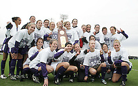 Portland players pose with the championship trophy. The University of Portland Pilots defeated the UCLA Bruins 4-0 to win the NCAA Division I Women's Soccer Championship game at Aggie Soccer Stadium in College Station, TX, Sunday, December 4, 2005.