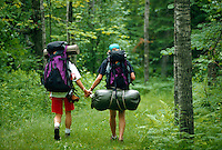 Backpackers hold hands along the trail in Jay Cooke State Park, Minnesota
