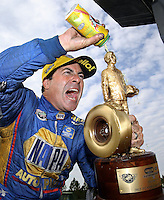 Mar 15, 2015; Gainesville, FL, USA; NHRA funny car driver Ron Capps celebrates after winning the Gatornationals at Auto Plus Raceway at Gainesville. Mandatory Credit: Mark J. Rebilas-