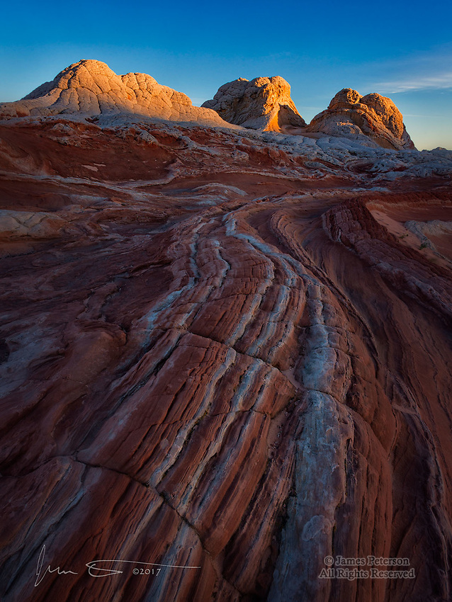 White Pocket Sunrise, Arizona  ©2017 James D Peterson.  This image is from a trip to Vermilion Cliffs National Monument in April, 2017.  The clear spring weather made for beautiful dawn light on the sculpted rock of this sublime landscape.