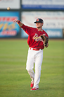 Luke Doyle (18) of the Johnson City Cardinals warms up in the outfield prior to the game against the Bristol Pirates at Howard Johnson Field at Cardinal Park on July 6, 2015 in Johnson City, Tennessee.  The Cardinals defeated the Pirates 8-2 in game two of a double-header. (Brian Westerholt/Four Seam Images)