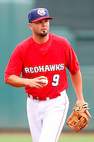Scott Moore (9) in action during the MiLB matchup between the Memphis Redbirds and the Oklahoma City Redhawks at Chickasaw Bricktown Ballpark on April 8th, 2012 in Oklahoma City, Oklahoma. The Redhawks defeated the Redbirds 8-1  (William Purnell/Four Seam Images)