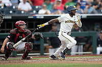 Michigan Wolverines outfielder Christian Bullock (5) follows through on his swing during Game 1 of the NCAA College World Series against the Texas Tech Red Raiders on June 15, 2019 at TD Ameritrade Park in Omaha, Nebraska. Michigan defeated Texas Tech 5-3. (Andrew Woolley/Four Seam Images)