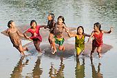Aldeia Baú, Para State, Brazil. Kokokinti, Irekabiri, Keitu, Bekoikuti, Kokodju, Nreki jumping into the river.