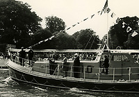 BNPS.co.uk (01202 558833)<br /> Pic: RNLI<br /> <br /> HM The Queen after the naming of 'The Royal British Legion Jubilee' lifeboat.<br /> <br /> Splash in the Attic...<br /> <br /> A 'lost' cache of 13,000 photographs charting the history of the RNLI has been found in the attic of the charity's headquarters.<br /> <br /> Many of the black and white photos date back to the 1920s and '30s long before the terms 'health and safety' and 'risk assessment' were thought of.<br /> <br /> One image depicts a brave lifeboatman dressed in a suit and cloth cap just as the lifeboat he is on launches down a ramp into a choppy sea.<br /> <br /> Another shows the crew of another open lifeboat getting swamped by waves with only their souwesters and lifejackets to protect them.<br /> <br /> The photos have been unearthed in storage space at the RNLI HQ in Poole, Dorset, and they are now being digitised.