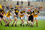 Dr Crokes David Carroll runs in to a wall of Abbeydorney defenders in the County Senior hurling championship game on Sunday