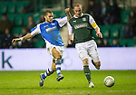 Hibs v St Johnstone.....11.02.13      SPL.Mehdi Abeid gets around James McPake.Picture by Graeme Hart..Copyright Perthshire Picture Agency.Tel: 01738 623350  Mobile: 07990 594431
