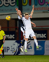 29th December 2020; Dens Park, Dundee, Scotland; Scottish Championship Football, Dundee FC versus Alloa Athletic; Charlie Adam of Dundee competes in the air with Innes Murray of Alloa Athletic