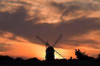 Weybourne, Norfolk, England, 03/08/2009..Weybourne windmill at sunset.