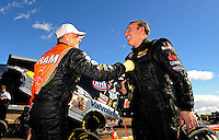 Feb. 22, 2010; Chandler, AZ, USA; NHRA top fuel dragster driver Cory McClenathan (left) is congratulated by Doug Kalitta after winning the Arizona Nationals at Firebird International Raceway. The race is being run Monday after weather and darkness led to the cancellation of Sunday race action. Mandatory Credit: Mark J. Rebilas-