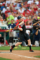 Macklemore bats during the All-Star Legends and Celebrity Softball Game on July 12, 2015 at Great American Ball Park in Cincinnati, Ohio.  (Mike Janes/Four Seam Images)