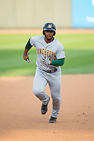 Bobby Bradley (44) of the Lynchburg Hillcats hustles towards third base against the Winston-Salem Dash at BB&T Ballpark on April 28, 2016 in Winston-Salem, North Carolina.  The Dash defeated the Hillcats 4-1.  (Brian Westerholt/Four Seam Images)