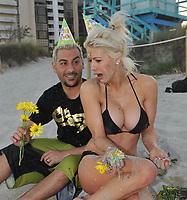 """MIAMI BEACH, FL - FEBRUARY 19:  (EXCLUSIVE COVERAGE)  Shayne and Nik Lamas-Richie are in Miami for Nik's 32nd Birthday celebration. The couple partied at Liv Nightclub than enjoyed a private afternoon filled with ice cream Birthday Cake, sand,and sun. The couple looked so much is love as a smoking hot Shayne in a little black bikini sang happy birthday to her husband. The couple than had a full blown cake fight. Our guess is you don't stay this in shape if you actually """"eat the cake"""".  Shayne and Nik are currently filming a reality Show the couple are trying to keep quite about production until filming ends due to media fire. Did Shayne Lamas Convince Nik into filming One! Probably going to be the most entertaining couple to watch but let's not hope for """"The reality show curse"""" as it will follow Shayne and Nik's Newlywed life . Will they end the curse or join the list of Hollywood Marriages ending in Divorce after Having a Reality Show ? <br /> <br /> Shayne Dahl Lamas (born November 6, 1985) is an American actress. She is known for her role as the Young Carly Corinthos on General Hospital (2005) and as the winner of the twelfth season of The Bachelor.  Lamas is the daughter of Renegade Actor Lorenzo Lamas and Michele Cathy Smith.  On April 18, 2010, she married Nik Richie, founder of the popular pseudo-celebrity gossip site TheDirty.com in Las Vegas. The two were married less than 12 hours after meeting, and they confirmed the nuptials on twitter. Following the wedding to Richie, she legally changed her name to Shayne Dahl Lamas-Richie.  on February 19, 2011 in Miami Beach, Florida.<br /> <br /> <br /> People:  Shayne Lamas_Nik Richie"""