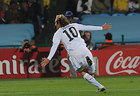 Midfielder Diego Forlan celebrates his long-distance strile, which gave Uruguay a 1-0 lead in the 24th minute. Uruguay defeated South Africa, 2-0, in both teams' second match of play in Group A of the 2010 FIFA World Cup. The match was played at Loftus Versfeld in Pretoria, South Africa June 16th.